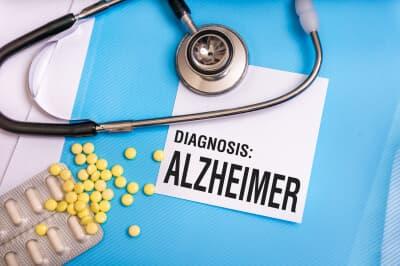 Alzheimer's word written on medical blue folder