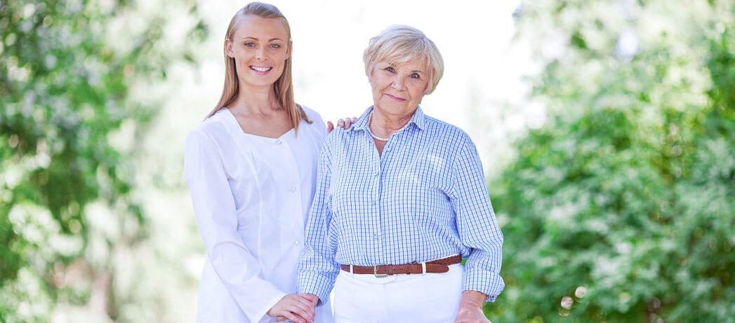 caregiver and senior woman smiling